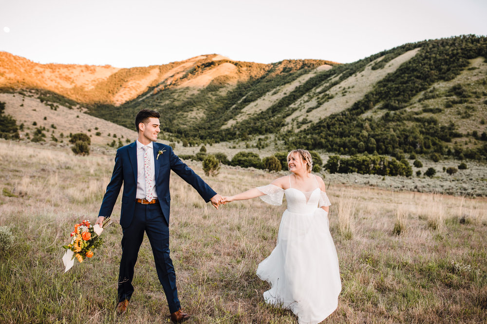 romantic mountain bridals professional formals photographer cache valley utah bohemian wedding in the mountains groom holding bouquet