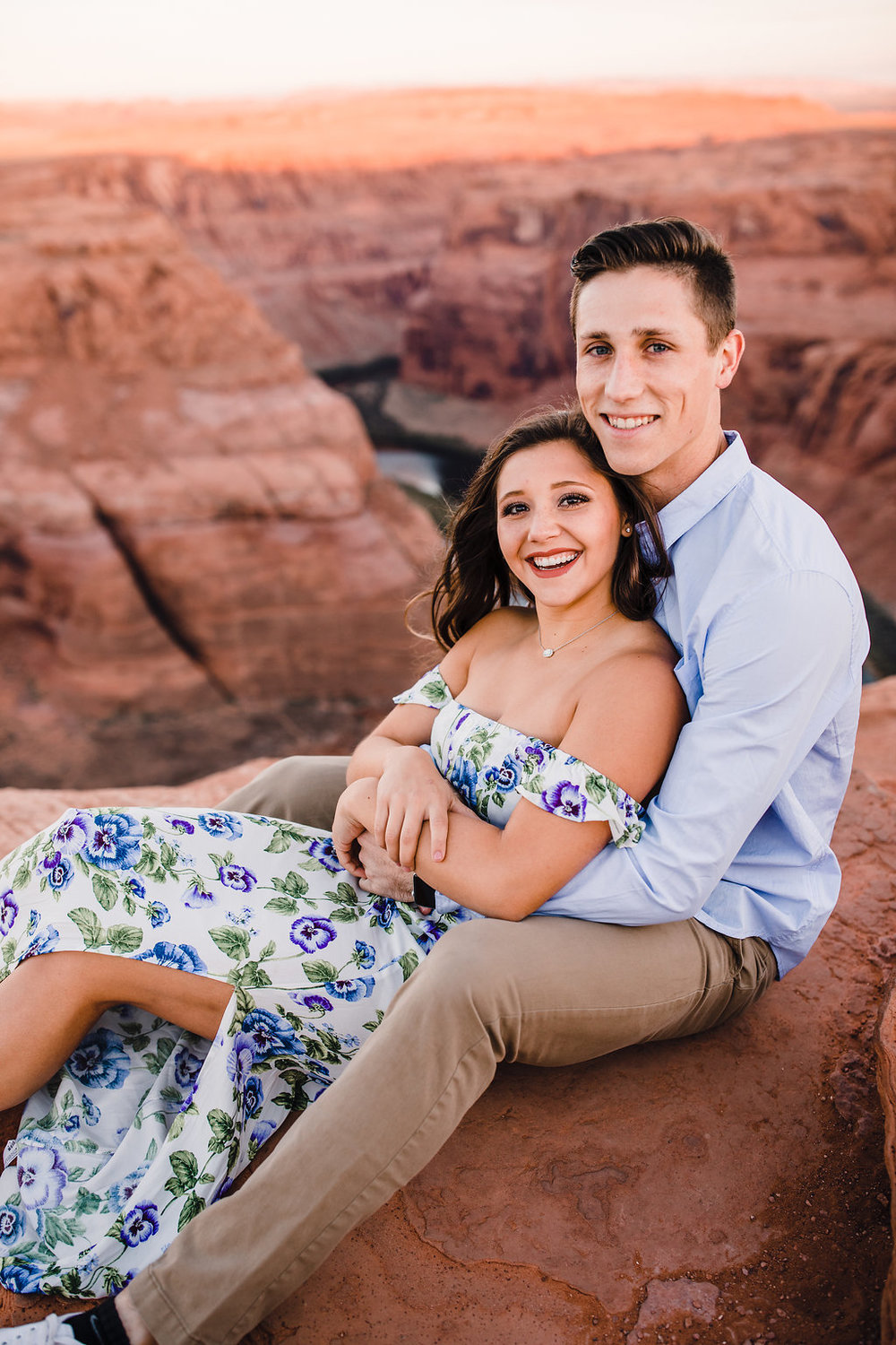 professional couples photographer grand canyon page arizona red rocks floral dress cuddling