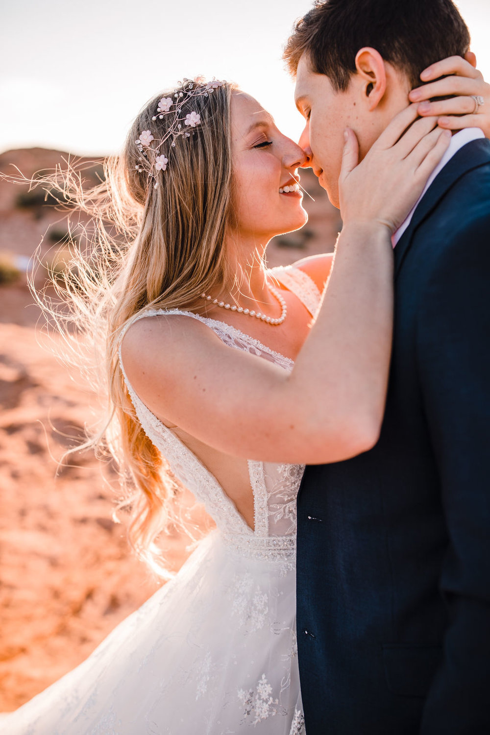 page arizona formal photographer best white dainty floral crown bohemian bride lace wedding dress kissing romantic