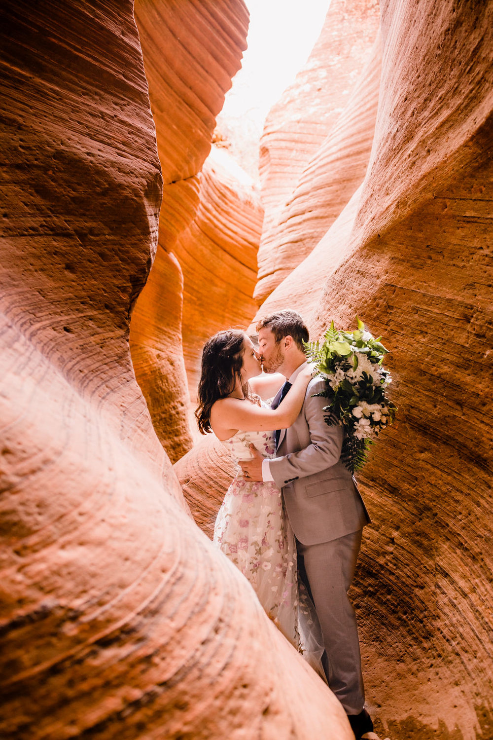 best horseshoe bend formal photographer red rock slot kissing romantic bohemian bride