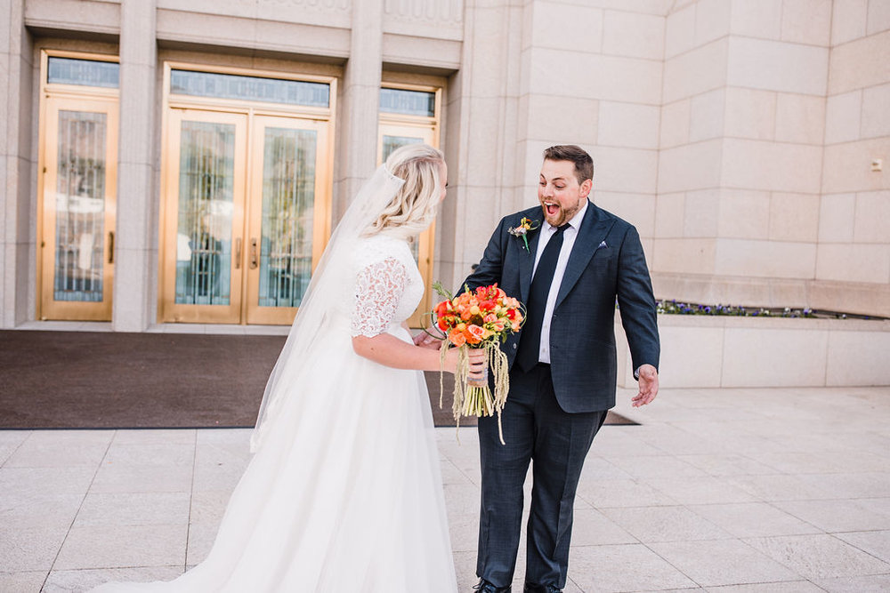 professional ogden utah photographer formals first look red and orange bouquet smiling happy