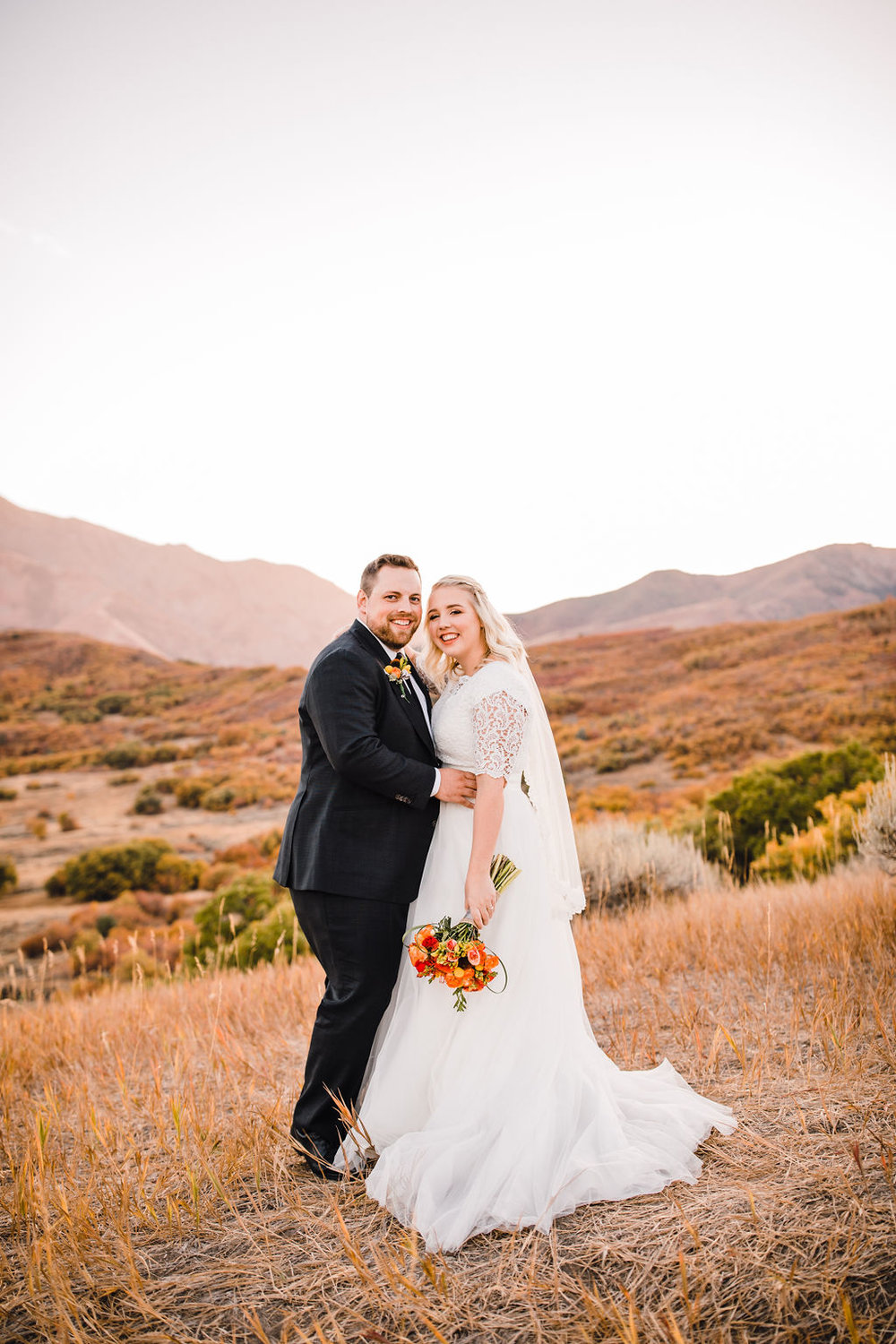 professional ogden utah formal photographer happy smiling red mountains sunset