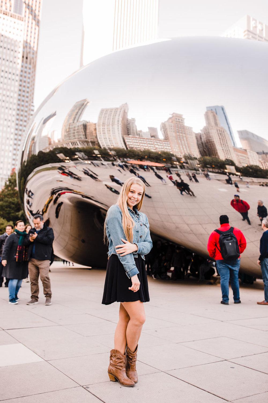 professional senior portrait photographer chicago illinois the bean smiling playful denim jacket