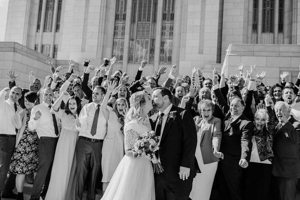 wedding exit best ogden utah wedding photographer cheering kissing romantic