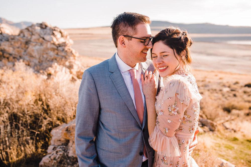bride and groom cuddling romantic blush wedding dress antelope island formals salt lake city wedding photographer northern utah