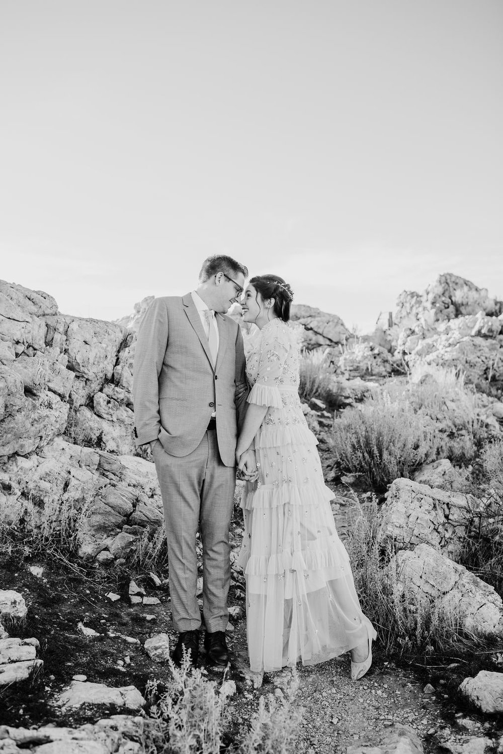 black and white formals photos romantic couple looking into each others eyes vintage wedding dress calli richards bridals wedding photography