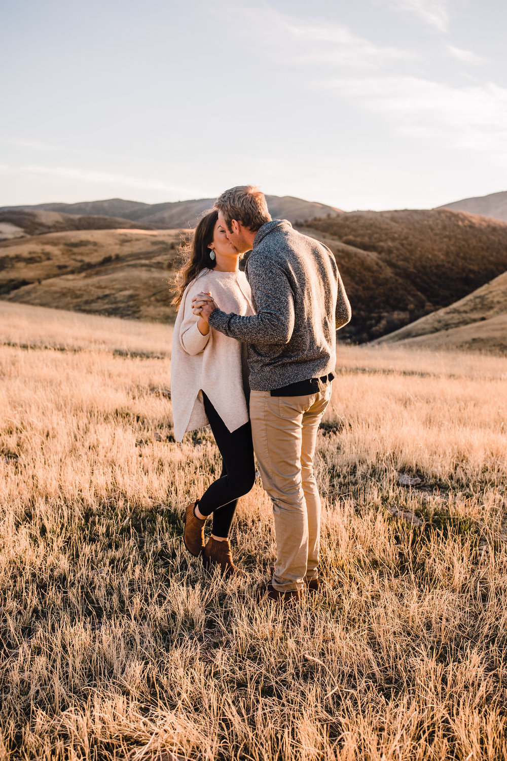 romantic mountain engagement session couple holding hands adventurous engagement photographer calli richards logan utah