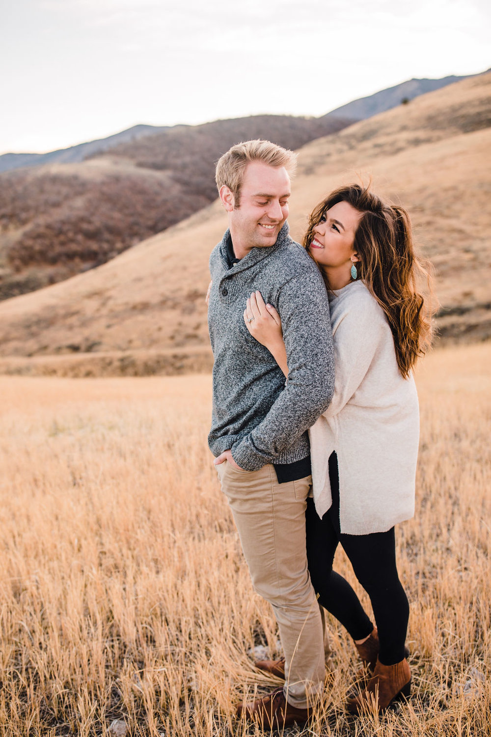 engagement photos northern utah mountains fall autumn classy cozy outfits snuggling couple calli richards