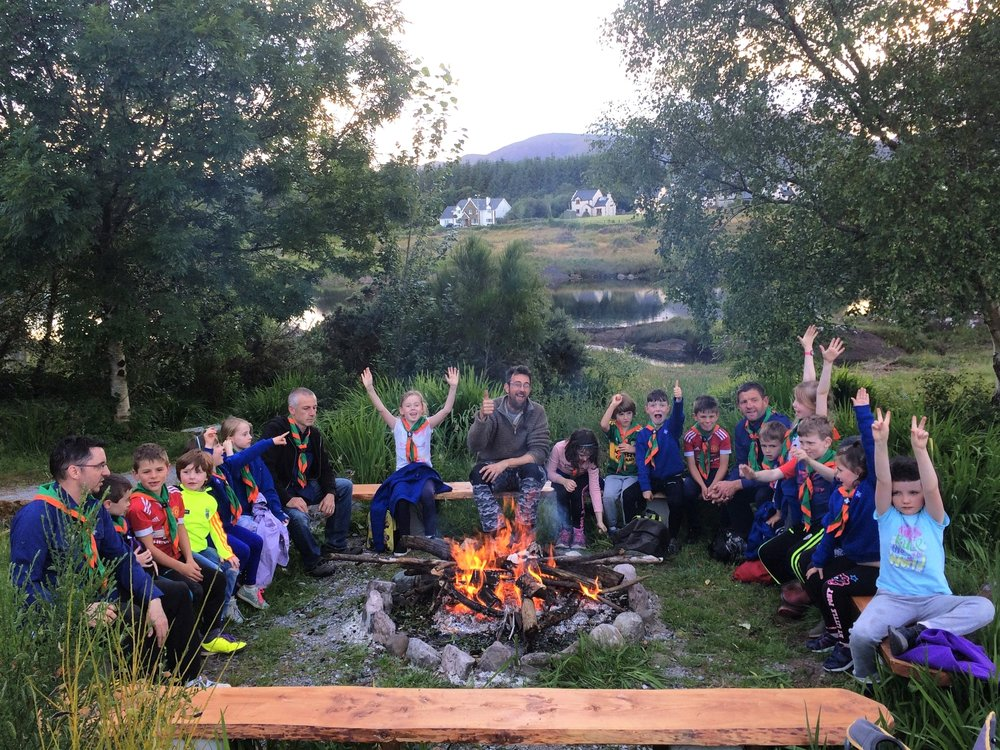 Sneem Scouts around the camp fire.