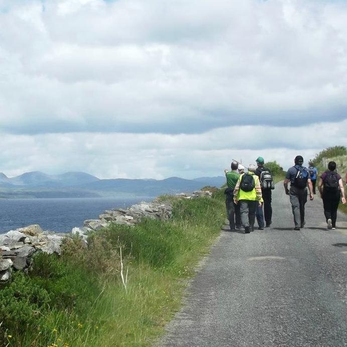 Local hillwalkers along Kenmare Bay.