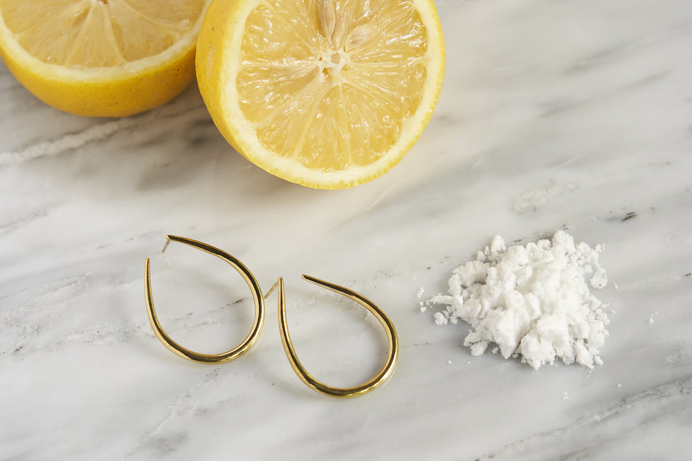 For restoring the shine   - Mix 2 tablespoons of lemon juice with 1 teaspoon of baking soda until it forms a paste-like texture.  - Apply the mixture onto your piece and rub with a cloth in one direction (or clockwise for round pieces like hoops and anklets).  - Wipe off the paste, rinse and pat dry.