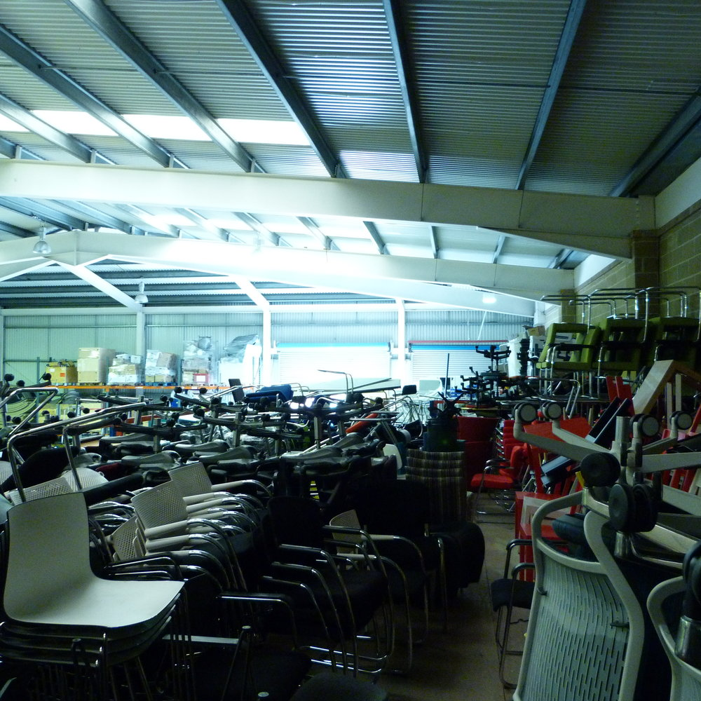 Just some of our seating range in the warehouse — no matter how big your team is be assured we can help you seat them, in comfort and in style!