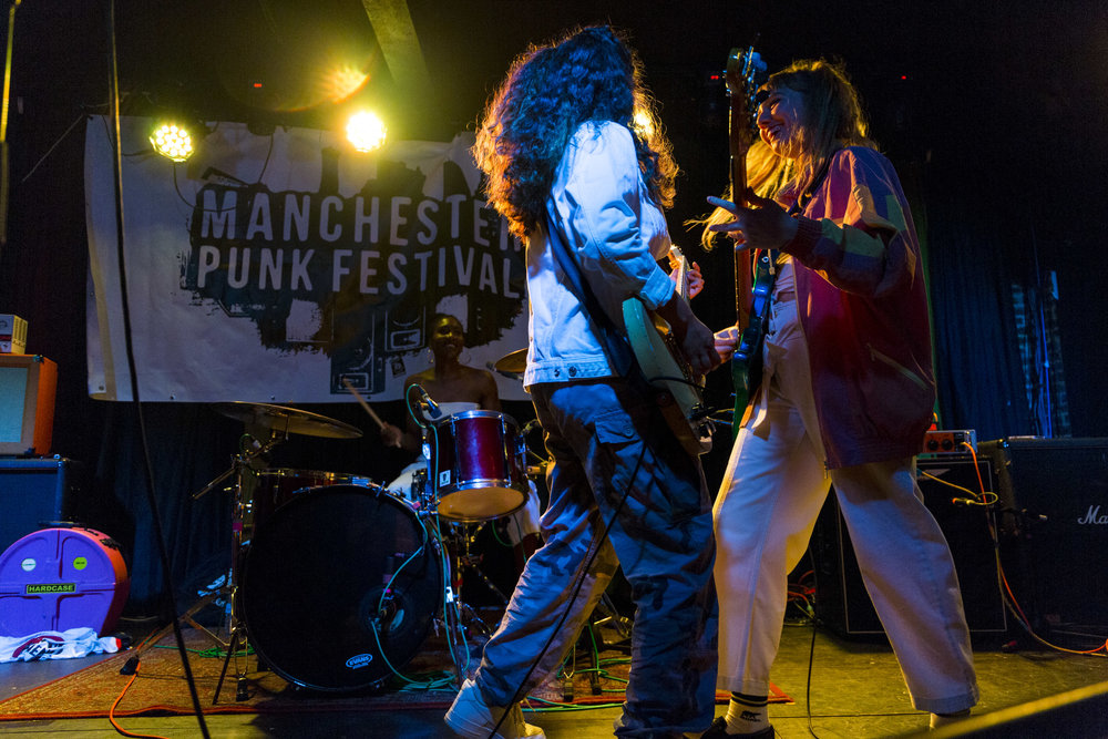 Manchester Punk Festival 2018 Highlights + Exclusive Interviews - Independent and inclusive, the third installment of Manchester Punk Festival spread its reach across multiple venues, with a multitude of musical acts and other cultural performances and premieres.