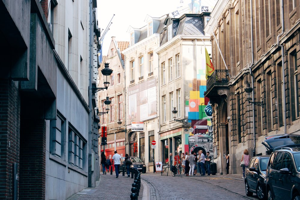 The paved streets of Brussels, Belgium. Photo by  Geoffroy Hauwen  on  Unsplash