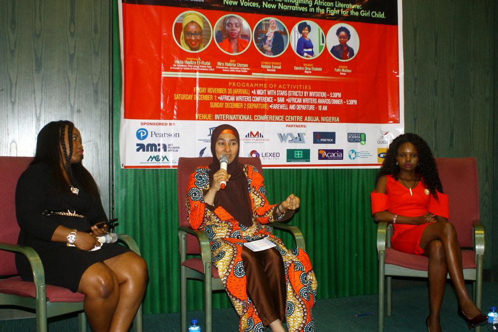 with panelists Sandra Etubiebi (Nigeria) and Faith Mutheu (Kenya) at the African Writers Conference, Abuja, Nigeria