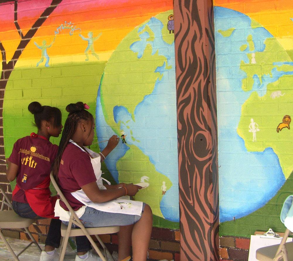 Girls painting world.jpg