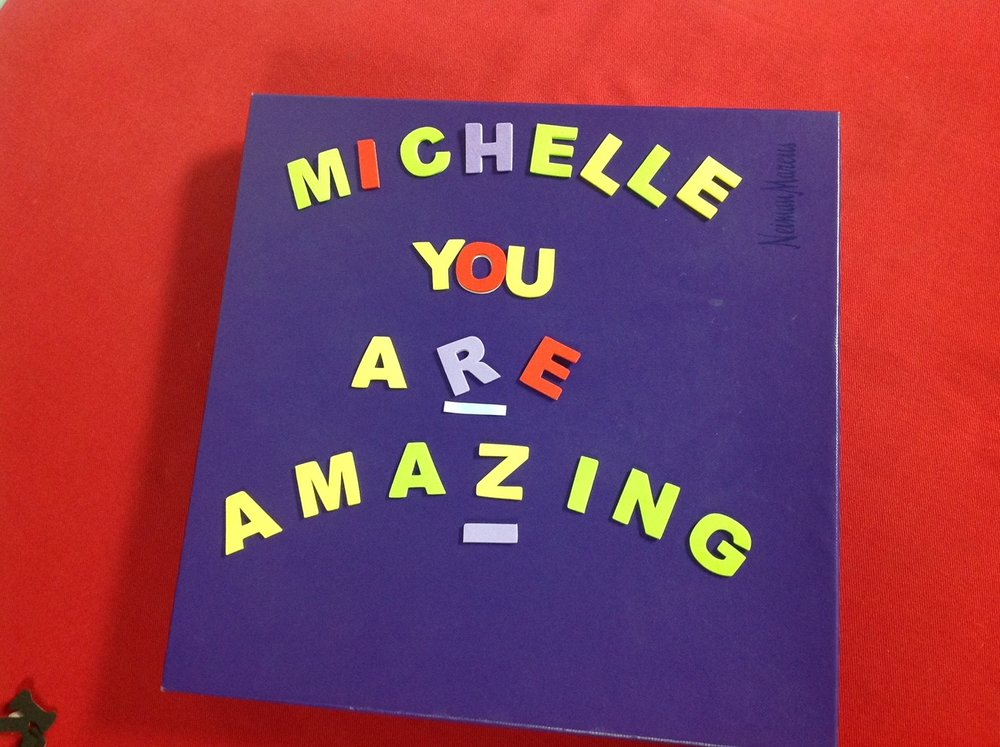 Michelle's mom, - unable to attend the race, made a sign at home and sent a picture to Michellefor support.Lynette is famousfor her cow-bell ringing at the races. She proudly rang herbell from home!