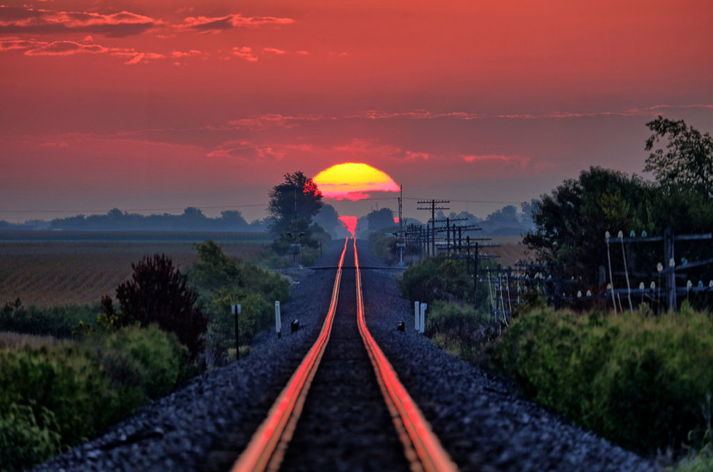 Sunrise on the Rails by Ray Cunningham