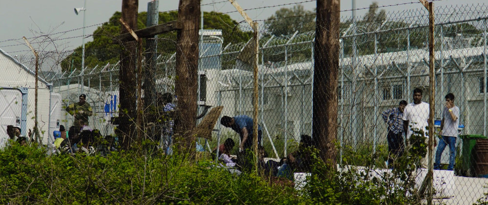 Refugees Behind Barbed Wire Fence in Camp on Lesvos Greece