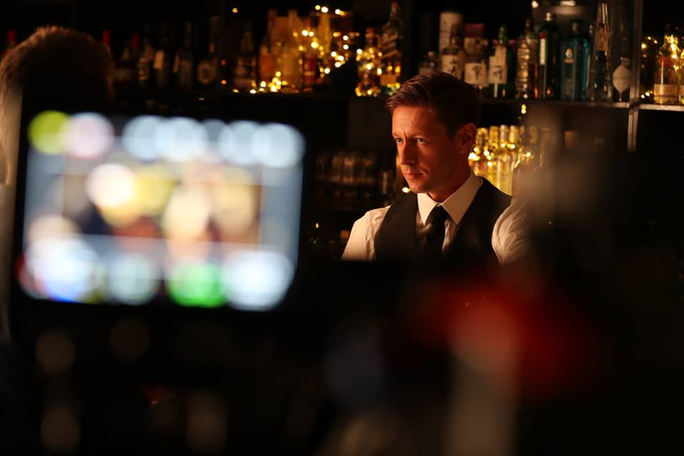 Cameron Pascoe as the bartender on set in the Giddy Goat cocktail bar during the making of Come Correct.  Image from the Come Correct - Short Film Facebook page.
