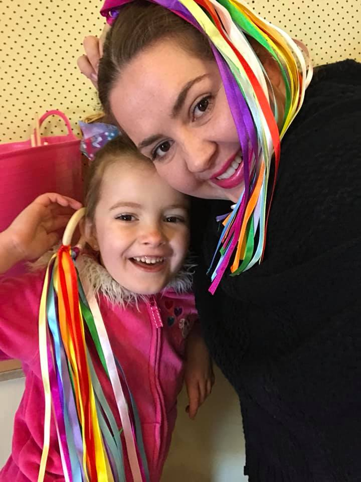Ms Rainbow: Biloela performing arts teacher Rhona Bechaz with five year old daughter Isla.