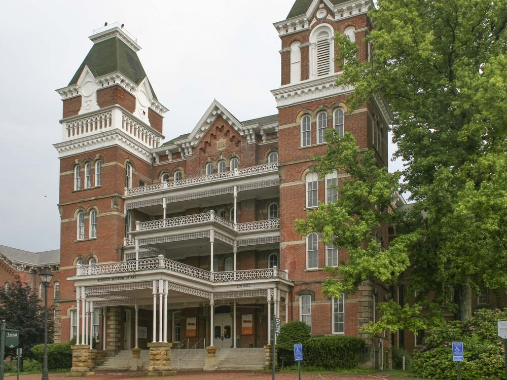 The portion of the Ohio University campus known as The Ridges consists of about 700 acres of land and about 40 buildings. A former State Mental Hospital facility, the property was transferred to the University in the 1980's and includes numerous historically significant buildings. While Schooley Caldwell was developing a Master Plan for these buildings, our physical assessments revealed that some buildings required immediate attention. Schooley Caldwell performed emergency repairs to seven of them, which included asphalt shingle and slate roofing repairs, and metal fascia, soffit, gutter and downspout repairs. The work remedied aspects of the roofing and roofing water removal systems that had failed and as a result were causing damage to the buildings. Roofing repairs to the asphalt shingle roofs consisted of patching and overlaying new shingles on the existing roof shingles. Some areas of shingles were removed to allow access to wood rafter, sheathing and fascia repairs.  Schooley Caldwell also conducted masonry restoration and repairs to brick masonry and stone masonry facades at nine buildings.
