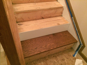 Removing the bullnoses & painting the risers - After that, it was time to cut the bullnoses off the old stairs and then measure, cut and paint the risers! I used a circular saw for cutting the bullnoses of the existing treads, but a reciprocating saw would work well, too. Pine wood chips easily, so a sharp chisel and hammer can be used to clean up the edges. I used a good quality white trim paint from Sherwin Williams for the risers, as well as for the sides of the stairs. The tread and riser for the first step are shown here..