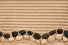 two-rows-stones-black-white-lying-striped-sand-space-text-view-above-92806847.jpg