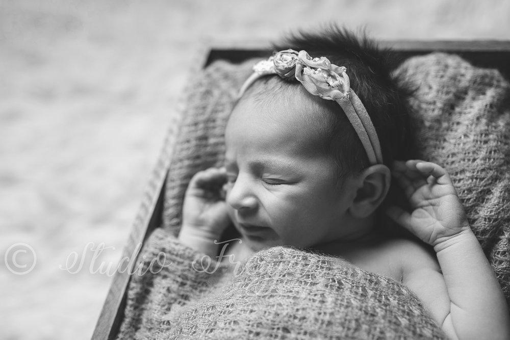 Black and White fine art newborn picture of baby girl by Studio Freyja a San Diego Newborn Photographer