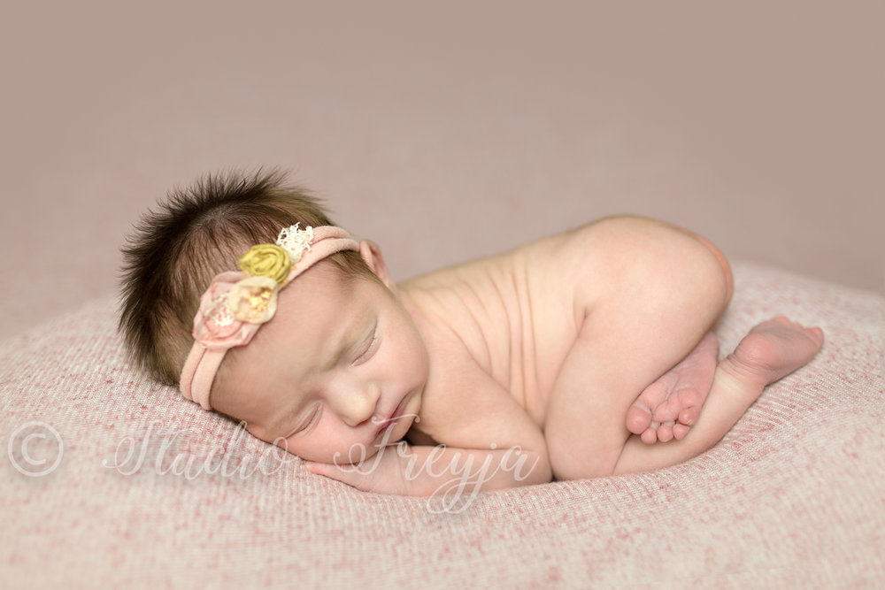 Pink backdrop for baby girl newborn pictures in San Diego by Studio Freyja