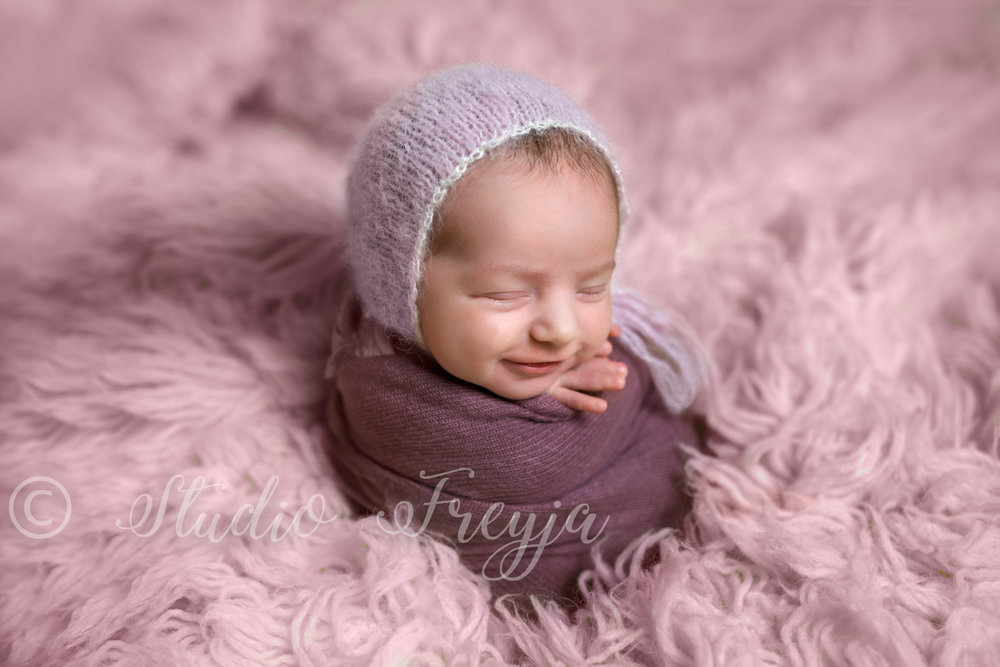 Smiling baby girl during San Diego Newborn Picture Session by Studio Freyja