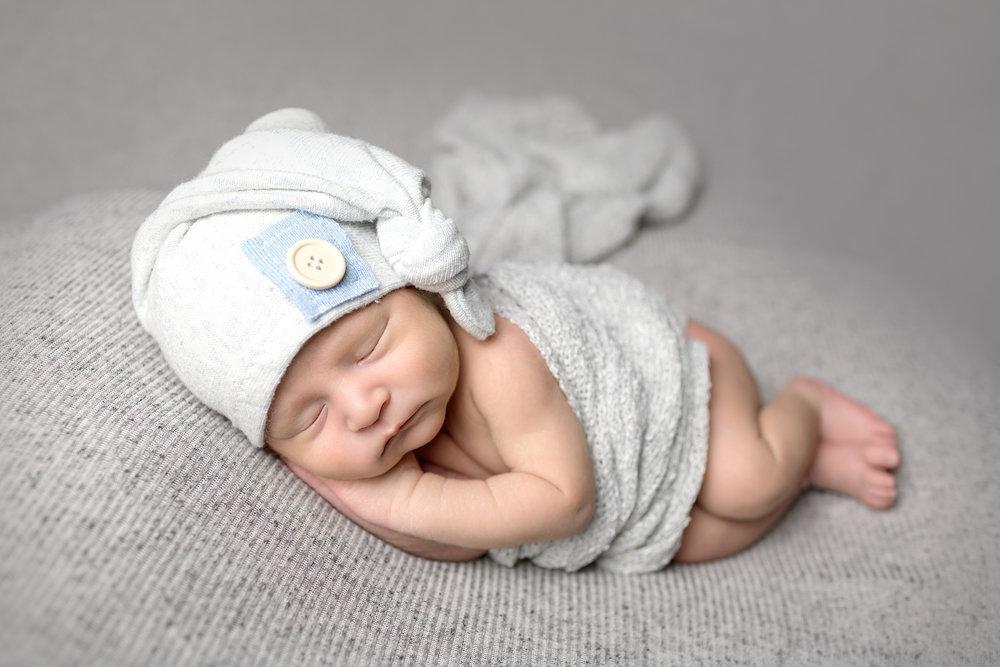 Leo Newborn Photography Session by San Diego Newborn Photographer utilizing sleepy cap