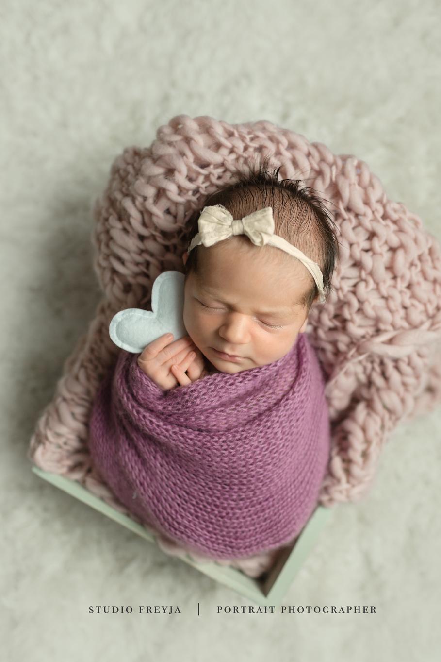 Holding Heart from Target San Diego Newborn Photographer