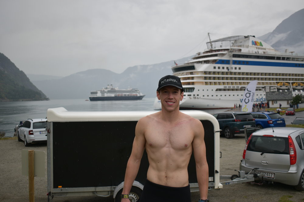 Standing by Hardangerfjord in Eidfjord after a practice swim