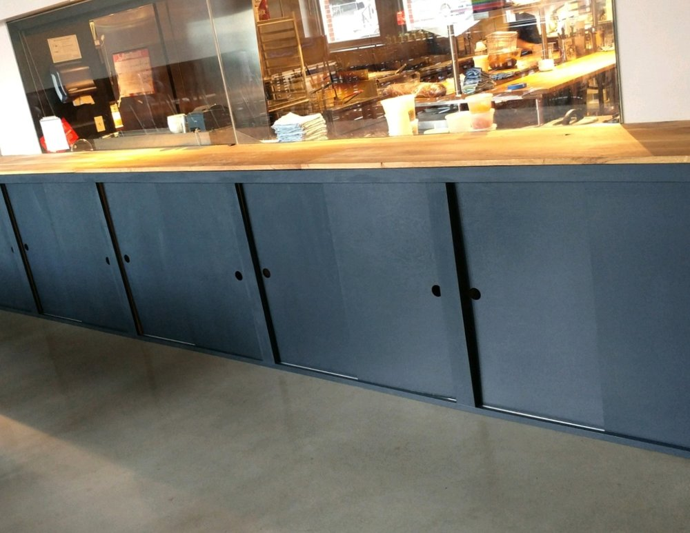 Custom cabinets built in the shop and assembled in place at the Buckman Public House in Portland, Oregon