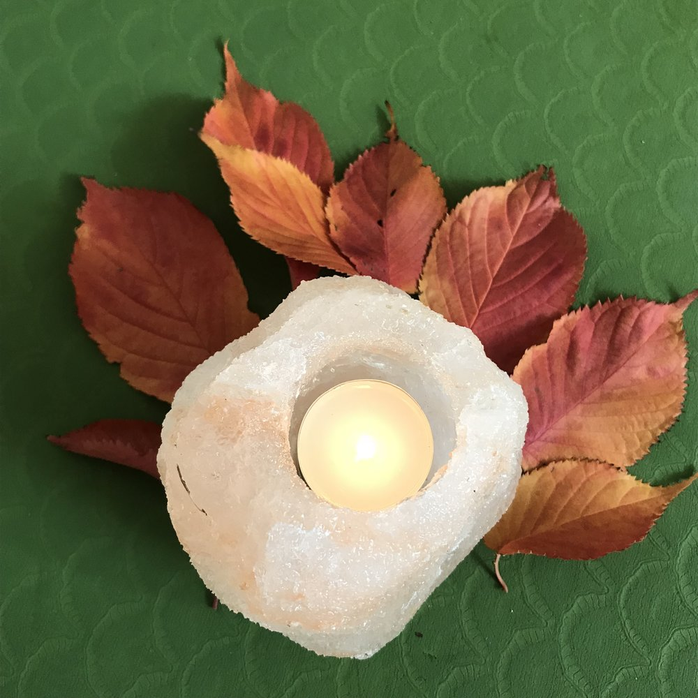Autumn alter - light a candle to create a simple autumn alter to centre your practice