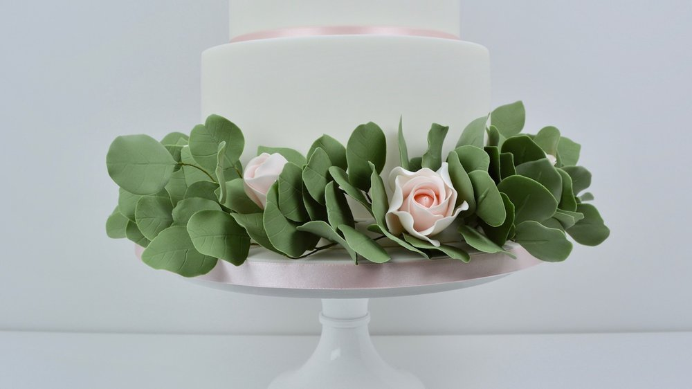 Roses and Silver Dollar - A lush silver dollar eucalyptus garland and pale pink roses adds striking greenery for elegant simplicity