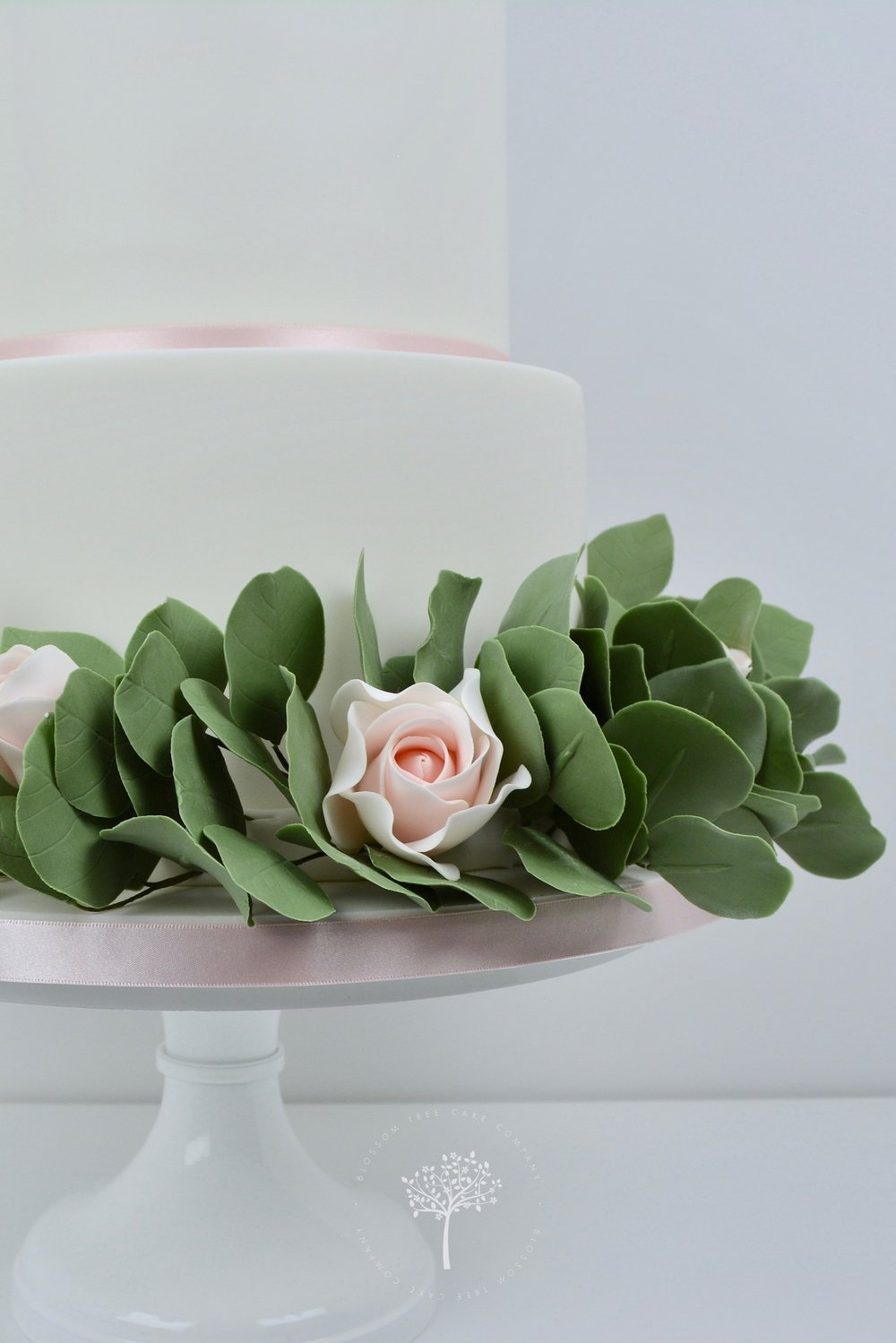 Roses and Silver Dollar wedding cake by Blossom Tree Cake Company - eucalyptus garland.jpg