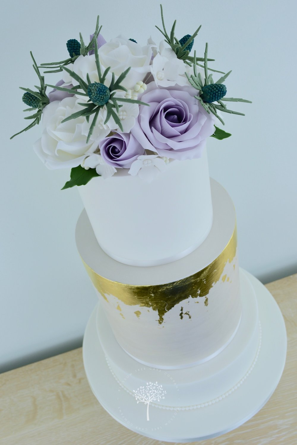 Sea Holly and Roses wedding cake by Blossom Tree Cake Company Harrogate North Yorkshire - angle.jpg