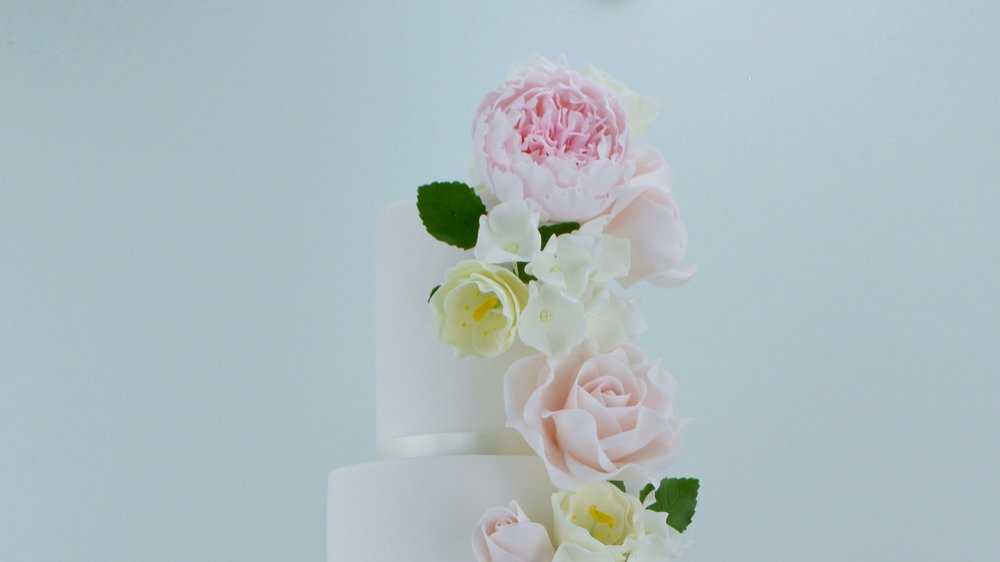Peonies, Roses and Lisianthus - Large fluffy peonies, roses and delicate lisanthus combined in beautiful pastel shades for a striking wedding cake