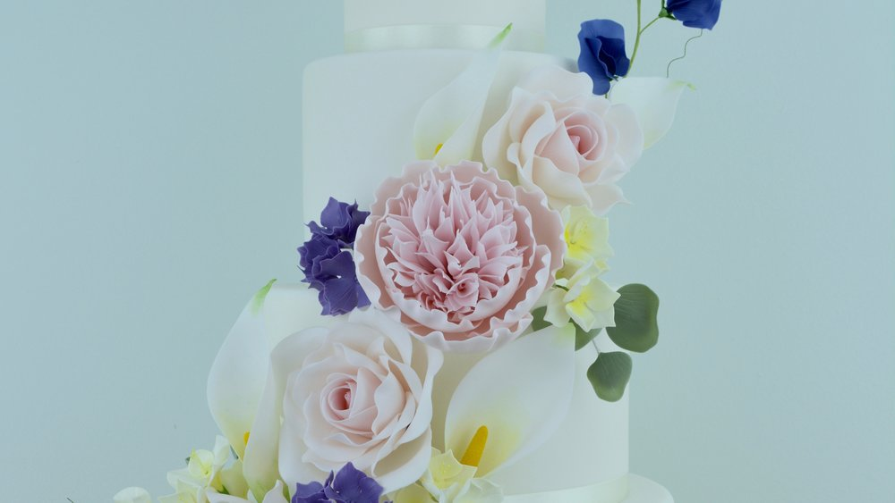 Dusky Pink Rose and Peony - A beautiful cascade of delicate sugar roses, peony, calla lilies, hydrangea, sweet peas & freesias for a stunning summer wedding cake