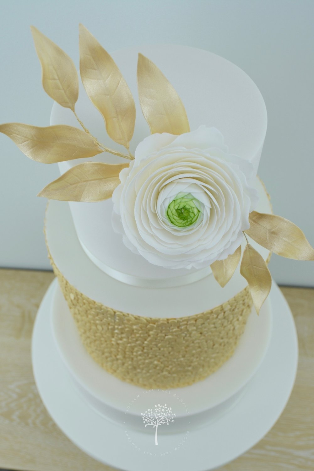 Ranunculus with Gold Sequins wedding cake by Blossom Tree Cake Company - angle.jpg