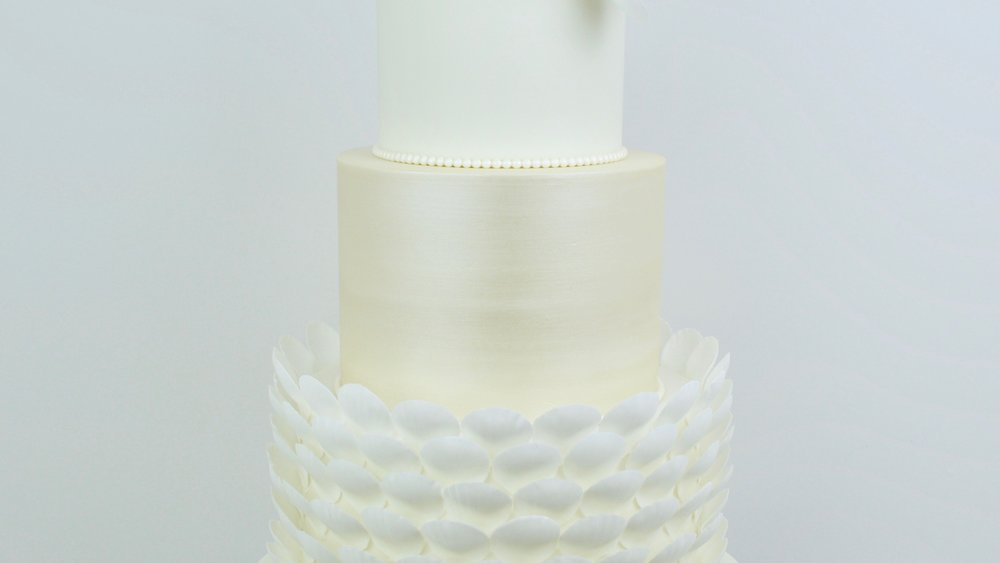 White Roses and Pearls - Champagne gold lustre and delicate petal shell decoration with string of pearl icing for an elegantly beautiful wedding cake