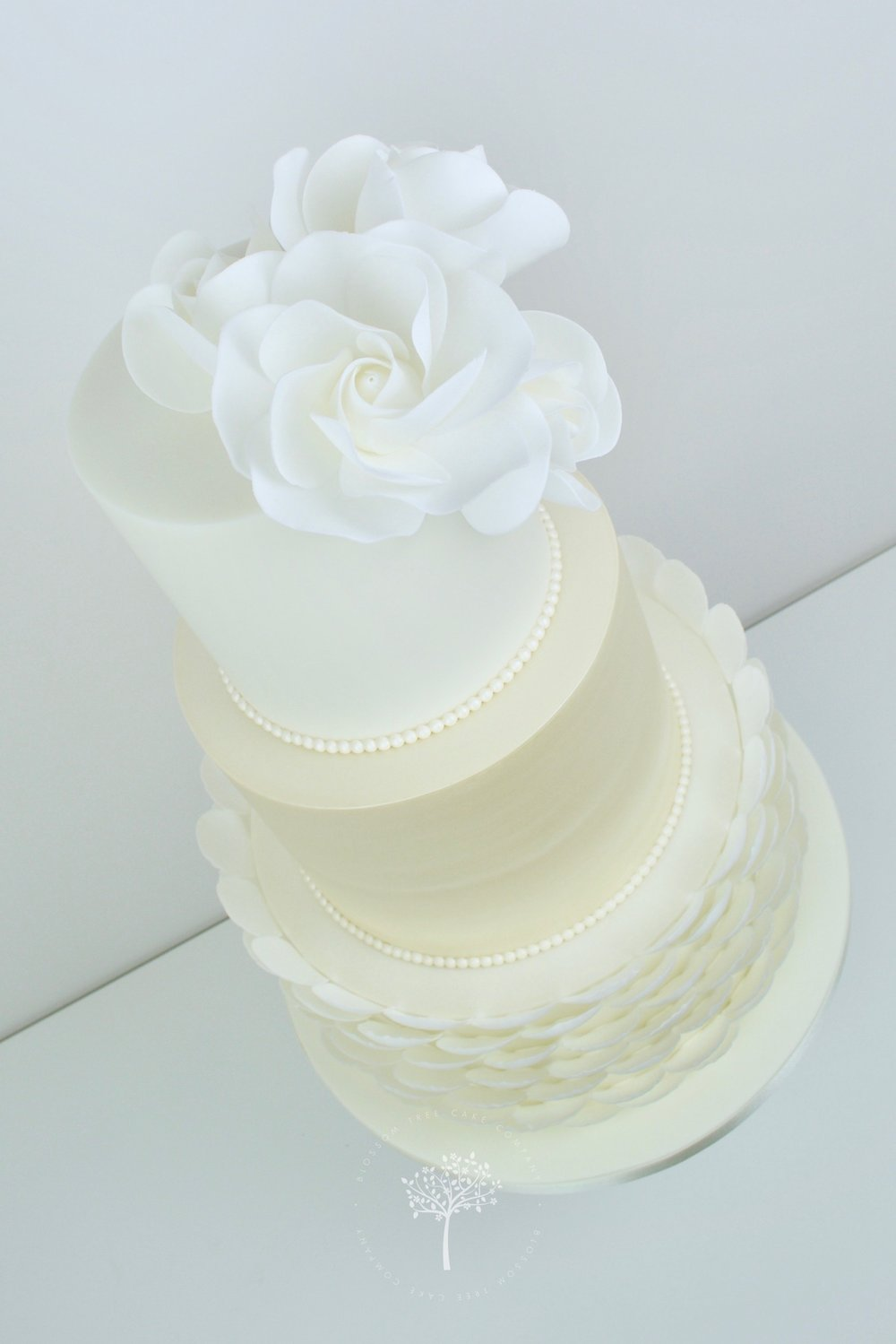 White Roses with Pearls wedding cake by Blossom Tree Cake Company Harrogate North Yorkshire - angle.jpg