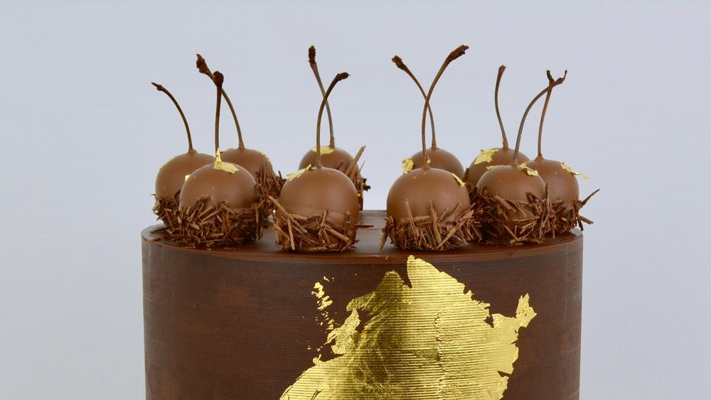 Chocolate and Cherries - Rich chocolate ganache and kirsch soaked cherries in Belgian milk chocolate splashed with gold leaf for a striking celebration cake