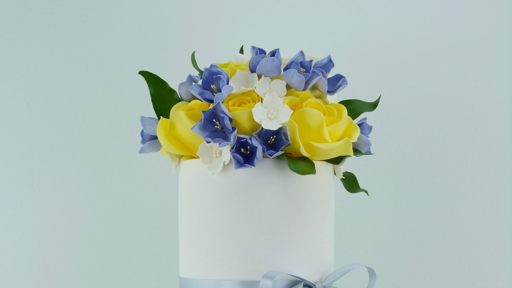 Freesias and Roses - Delicate blue freesias and yellow roses for a celebration cake in Yorkshire's colours!