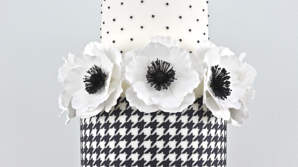 Houndstooth and Anenome - Bold design matched with striking anemone flowers for a celebration cake with timeless elegance