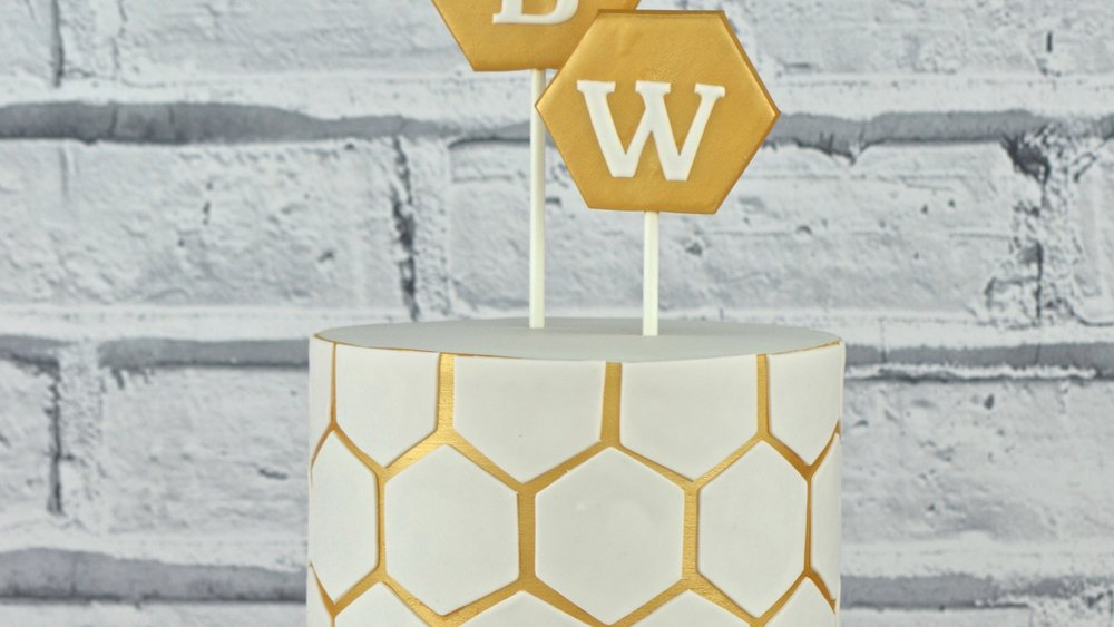Honeycomb - Bold geometric gold and white hexagon design celebration cake with birthday initials