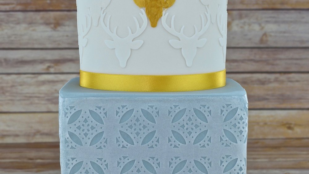 Gold Stag - An impressive celebration cake with contrasting edible rice paper lace and stags head design
