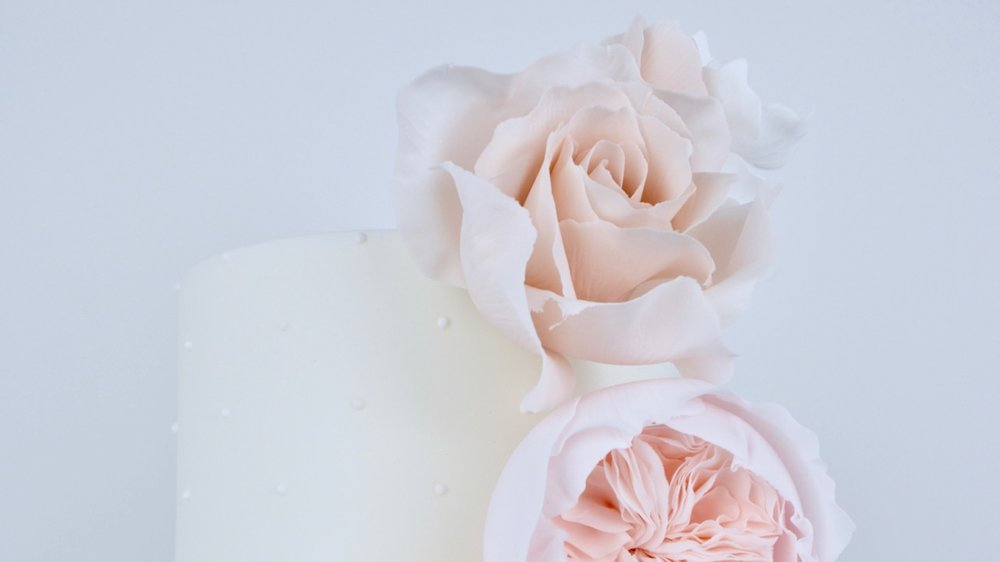Peach Roses and Peonies - A gorgeous vertical cascade of David Austin roses, nude roses, gardenia peonies and white hydrangea for a showstopper cake